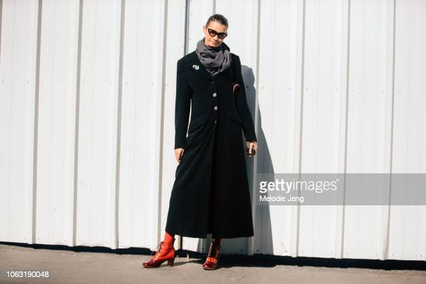 Model Sveta Black wears a black coat and red boots after the Balenciaga show during Paris Fashion Week Spring/Summer 2019 on September 30 2018 in...