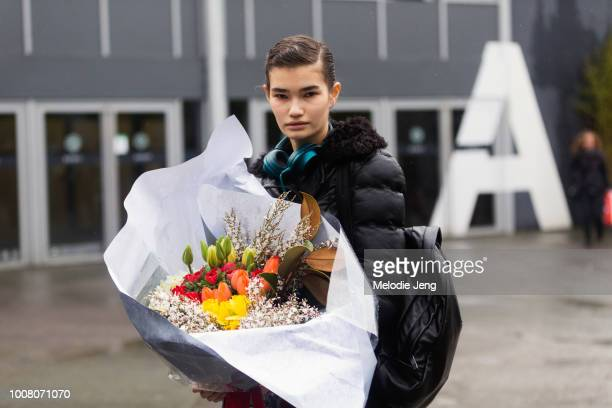 Model Sveta Black with a bouquet of flowers from Moulié Fleurs after Balenciaga during Paris Fashion Week Fall/Winter 2017 on March 5 2017 in Paris...