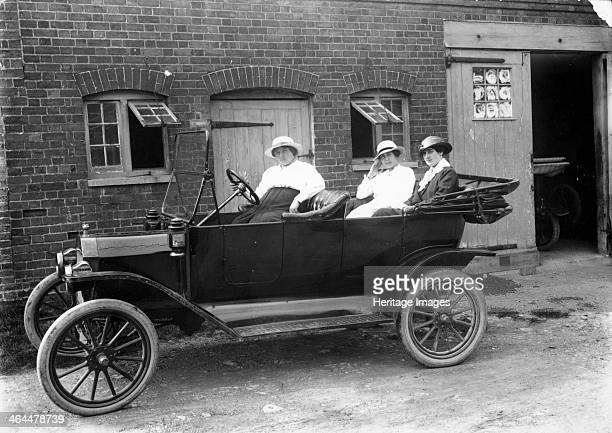 Model T Ford c1913 Three women sitting in a Model T Ford parked in front of a building Henry Ford introduced the Model T in 1909 and the company's...