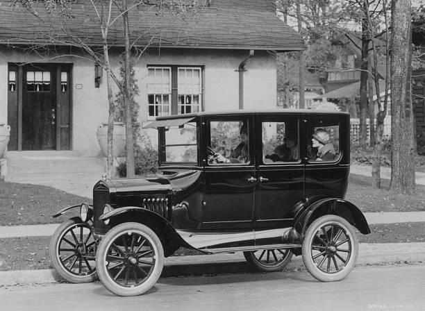 A model 'T' Ford motor-car outside a suburban house....