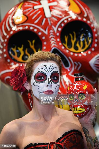 Model Tabitha Bass poses with Sangre de Vida Tequila during the 30th annual Nightclub Bar Convention and Trade Show at the Las Vegas Convention...