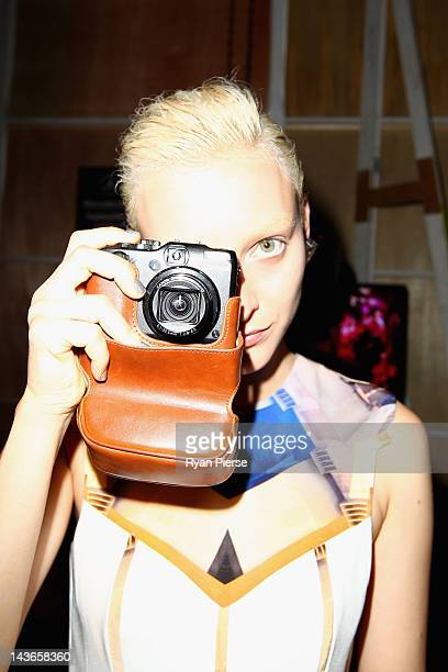 A model takes a photo with a camera backstage ahead of the An Ode To No One show on day three of MercedesBenz Fashion Week Australia Spring/Summer...