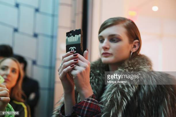 A model takes a selfie backstage at the Calvin Luo fashion show during New York Fashion Week on February 13 2018 in New York City
