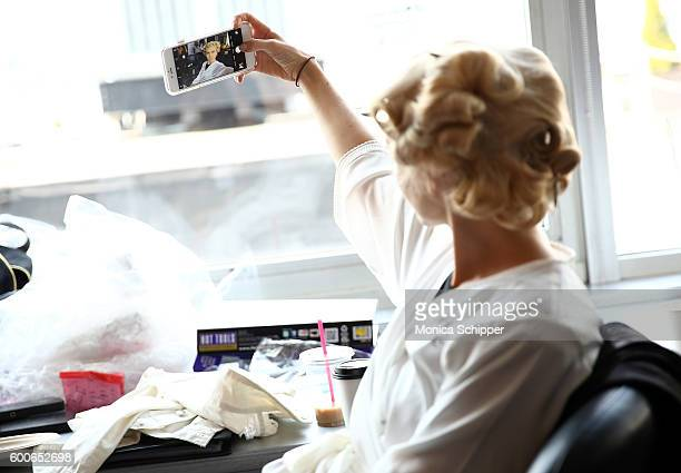 A model takes a selfie backstage at the Fashion Palette Australian Swim/Resort fashion show during New York Fashion Week September 2016 at Pier 59...