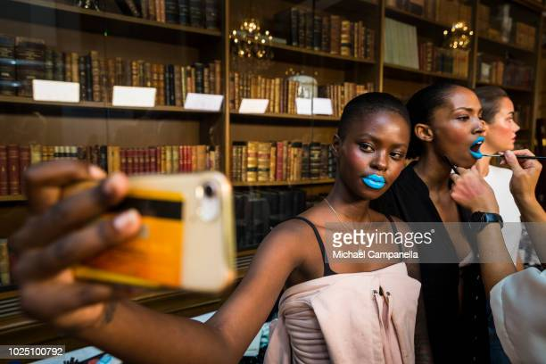 A model takes a selfie backstage on the second day of Fashion Week Stockholm at the Grand Hotel on August 29 2018 in Stockholm Sweden