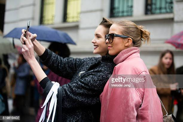 A model takes a selfie with blogger Jessica Mercedes at the Marni show during the Milan Fashion Week Fall/Winter 2016/17 on February 28 2016 in Milan...