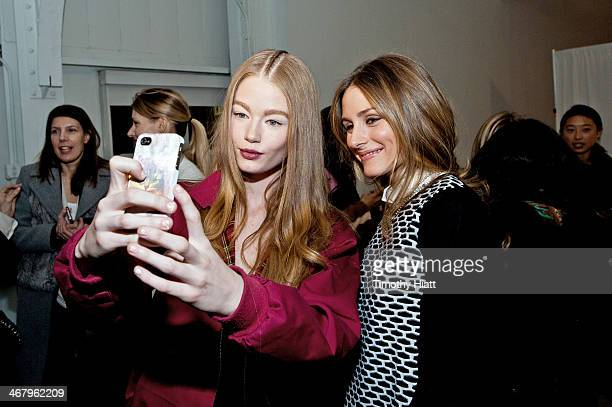 A model takes a selfie with Olivia Palermo backstage at the Tibi fah MercedesBenz Fashion Week Fall 2014 at Pier 59 on February 8 2014 in New York...