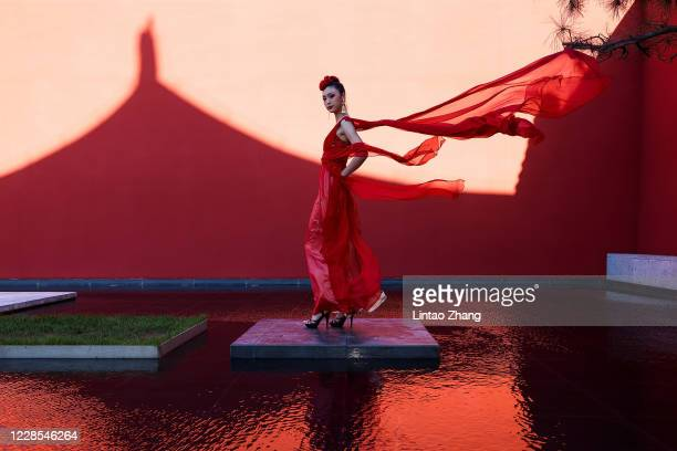 "Model takes part in a dress rehearsal before the presentation of the ""idol lady2020"" collection show during the day two of Beijing Fashion Week at..."