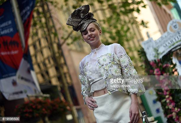 A model takes part in a fashion parade in conjunction with the Melbourne Cup in Sydney on November 1 2016 Almandin beat Heartbreak City by a nose in...