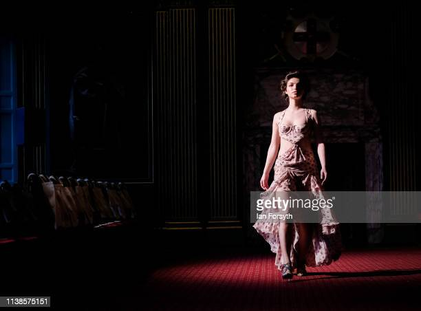 A model takes part in rehearsals for a fashion showcase from international designer Scott Henshall and Lady Victoria Hervey at York Mansion House...
