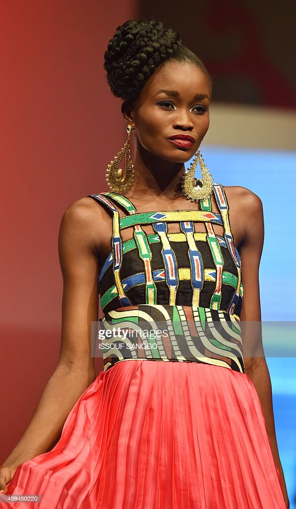 A Model Takes Part In The 9th 'Afrik Fashion' In Abidjan