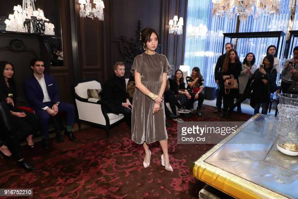 A model takes part in the Jasmine Chong x GBGH Fall 2018 New York Fashion Week Presentation at Baccarat Hotel on February 10 2018 in New York City