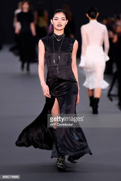 A model takes part in the L'Oreal fashion show on the sidelines of the Paris Fashion Week on October 1 on a catwalk set up on the ChampsElysees...