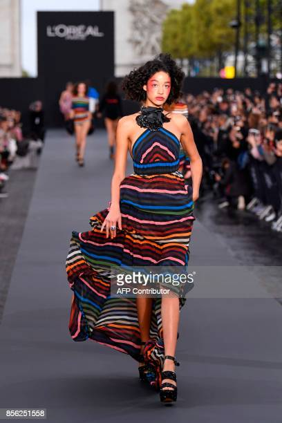A model takes part in the L'Oreal fashion show which theme is Paris on the sidelines of the Paris Fashion Week on a catwalk set up on the...