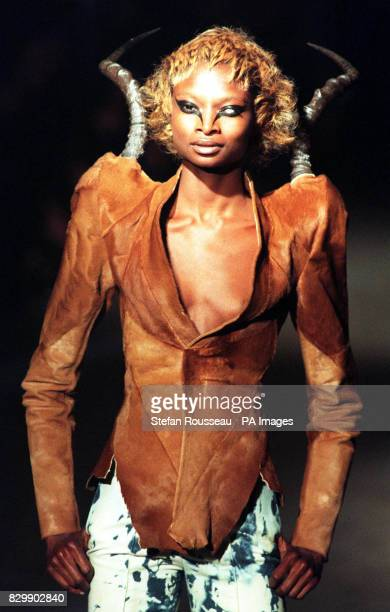 Model takes to the catwalk in a devilish hide jacket and bleached denims, from designer Alexander McQueen, on the fifth day of London Fashion Week...