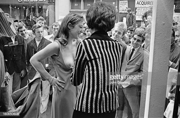 A model taking part in a risque photoshoot in the window of a new Henry Moss boutique in Carnaby Street London 11th May 1966