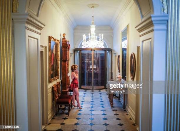 A model talks on her phone ahead of a fashion showcase from international designer Scott Henshall and Lady Victoria Hervey at York Mansion House...