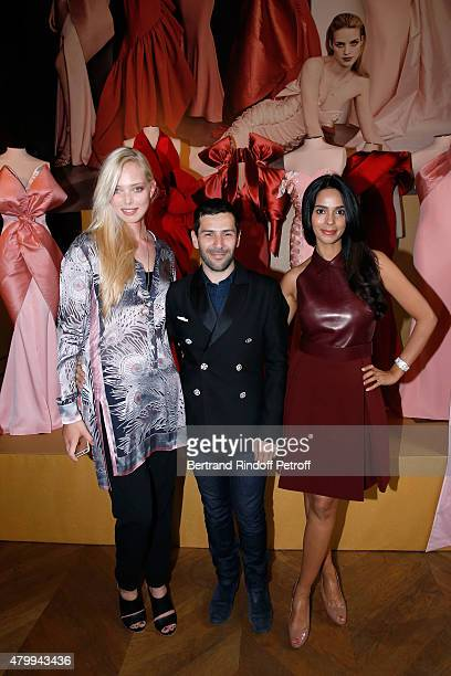 Model Tanya Dziahileva, Fashion Designer Alexis Mabille and Actress Mallika Sherawat attend the Presentation of the Alexis Mabille Haute Couture...