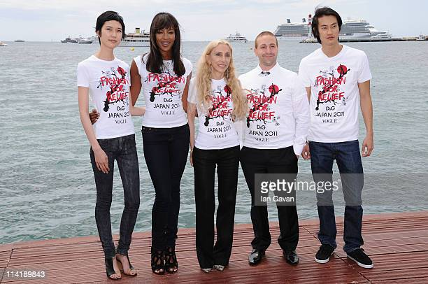 Model Tao Okamoto model Naomi Campbell Editor inchief of Vogue Italy Franca Sozzani Head of Campaigns for the Red Cross Zach Abraham and model Philip...