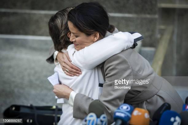 Model Tarale Wulff an alleged victim of former Weinstein Co CoChairman Harvey Weinstein right hugs attorney Gloria Allred before speaking to members...