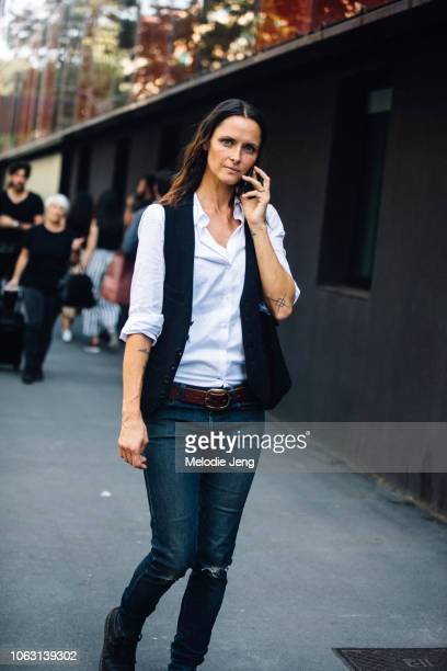Model Tasha Tilberg talks on the phone after the Etro show during Milan Fashion Week Spring/Summer 2019 on September 21 2018 in Milan Italy