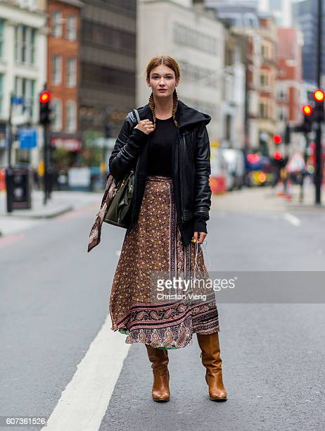 Model Tatiana Galic wearing a maxi skirt leather jacket and brown boots during London Fashion Week Spring/Summer collections 2017 on September 17...