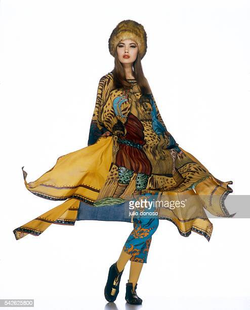 Model Tatiana wears women's fashions by Russian fashion designer Irina Kouznetsov in Paris. Her outfit includes a fur hat and a long tunic of...