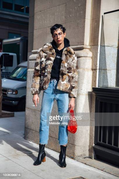 Model Tayler Nunes wears a rabbit fur jacket blue jeans black booties and a red orientalstyle purse after the Palomo show during New York Fashion...