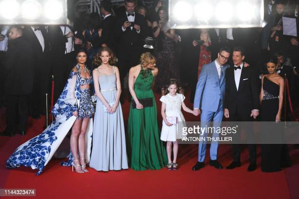 Model Taylor Hill , Danish director Nicolas Winding Refn and his wife Liv Corfixen and children Lola and Lizzie and US actor Miles Teller and his...
