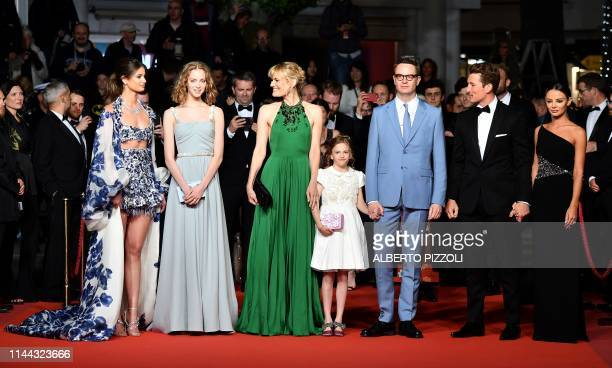 US model Taylor Hill Danish director Nicolas Winding Refn and his wife Liv Corfixen and children Lola and Lizzie and US actor Miles Teller and his...