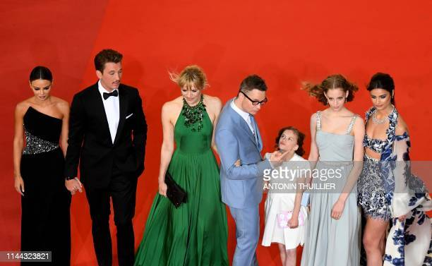 US model Taylor Hill Danish director Nicolas Winding Refn and his wife Liv Corfixen their children Lola and Lizzie and US actor Miles Teller and his...