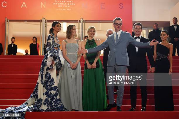 US model Taylor Hill Danish director Nicolas Winding Refn and his wife Liv Corfixen their children Lola US actor Miles Teller and his partner Keleigh...