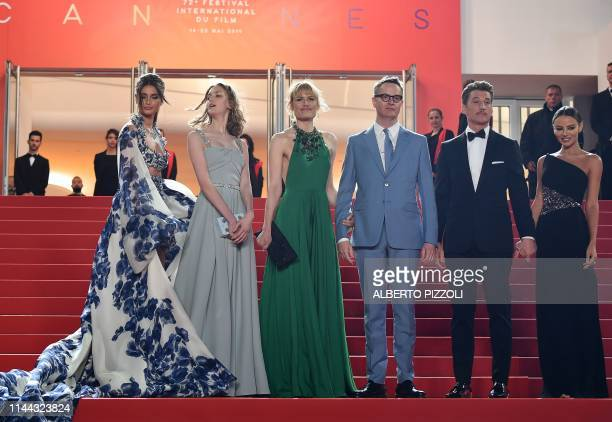 Model Taylor Hill , Danish director Nicolas Winding Refn , his wife Liv Corfixen and daughter Lola and US actor Miles Teller and his partner Keleigh...