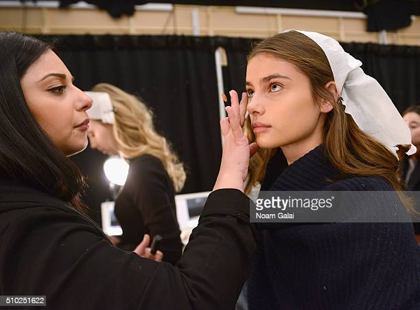 Model Taylor Hill prepares backstage at the Noon By Noor Fall 2016 fashion show during New York Fashion Week The Shows at The Dock Skylight at...