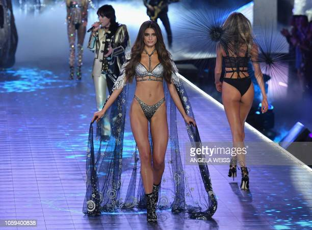 US model Taylor Hill walks the runway at the 2018 Victoria's Secret Fashion Show on November 8 2018 at Pier 94 in New York City Every year the...