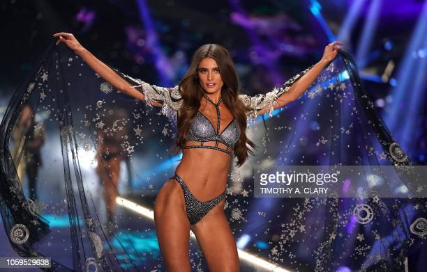 Model Taylor Hill walks the runway at the 2018 Victoria's Secret Fashion Show on November 8, 2018 at Pier 94 in New York City. - Every year, the...