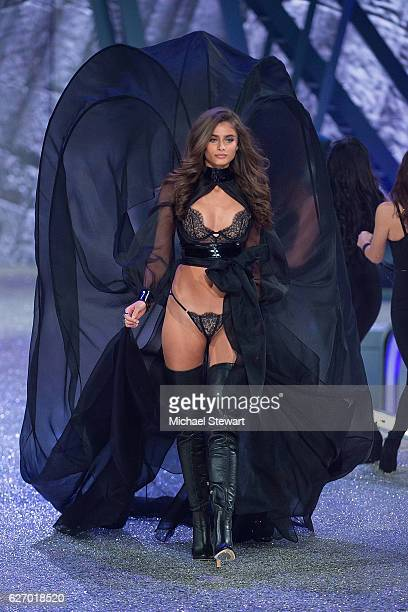 Model Taylor Hill walks the runway during the 2016 Victoria's Secret Fashion Show at Le Grand Palais in Paris on November 30 2016 in Paris France