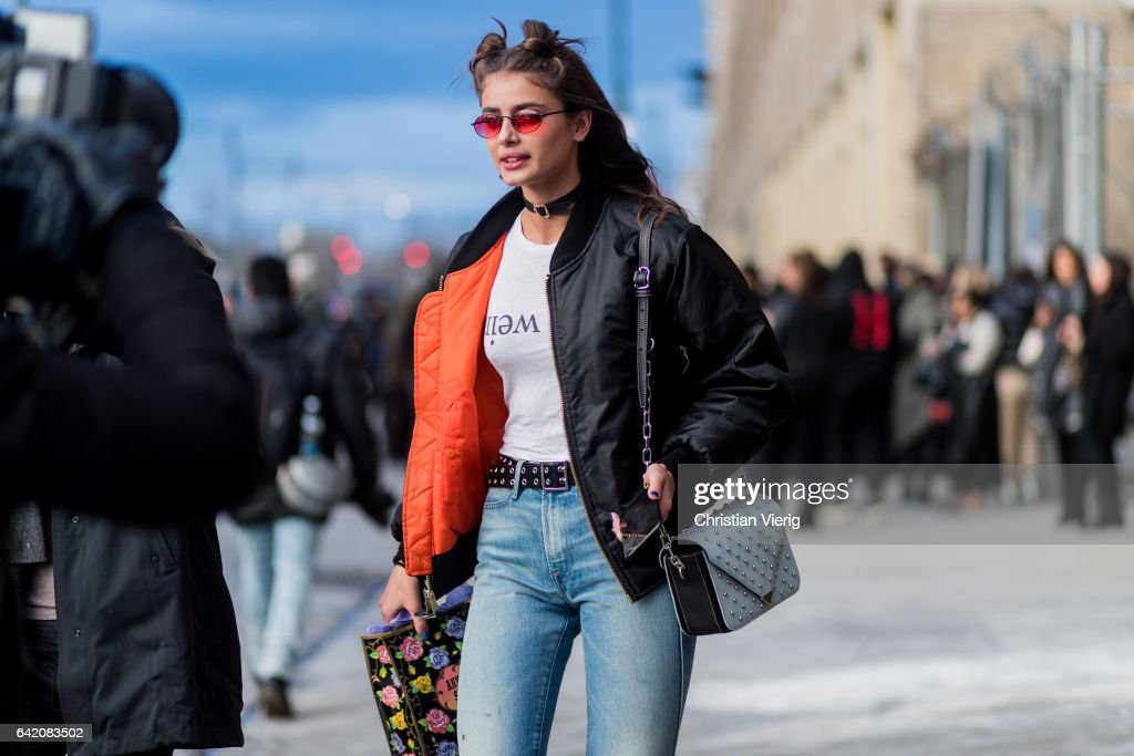 Model Taylor Hill wearing a black bomber jacket outside Anna Sui on February 15, 2017 in New York City.