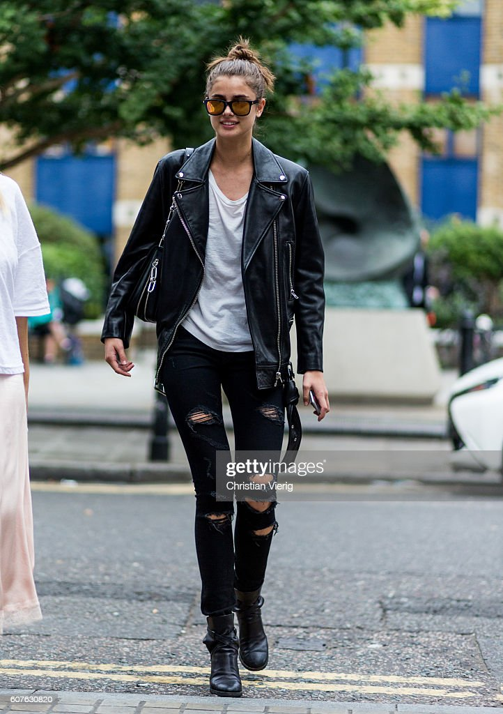 Model Taylor Hill wearing black leather jacket and ripped black jeans outside Topshop during London Fashion Week Spring/Summer collections 2017 on September 18, 2016 in London, United Kingdom.