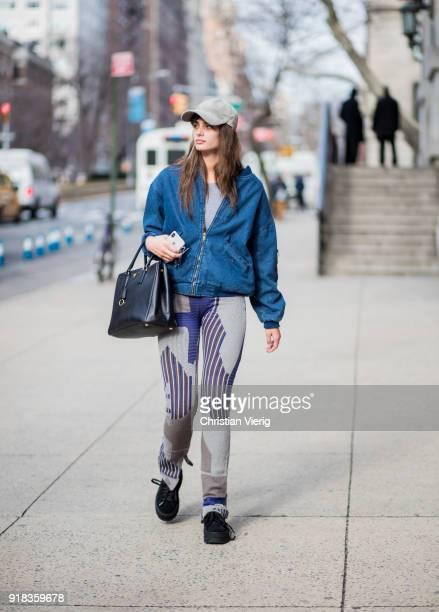 Model Taylor Hill wearing cap denim jacket leggings seen outside Marc Jacobs on February 14 2018 in New York City