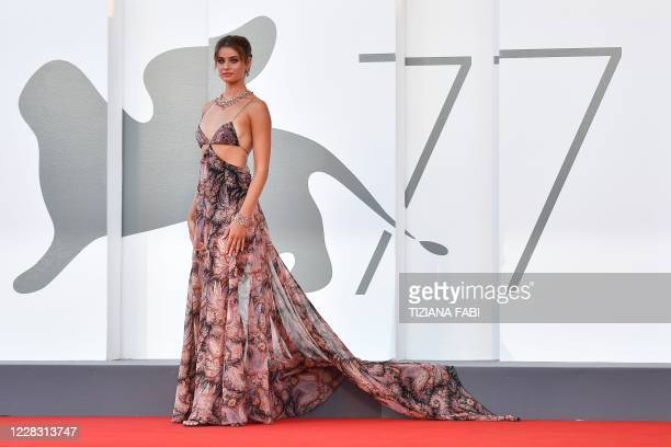 """Model Taylor Marie Hill arrives for the opening ceremony and the screening of the film """"Lacci"""" on the opening day of the 77th Venice Film Festival,..."""