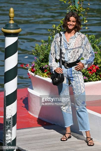 Model Taylor Marie Hill poses at the pier of the Excelsior Hotel on the opening day of the 77th Venice Film Festival, on September 2, 2020 at Venice...