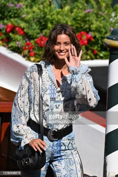 Model Taylor Marie Hill waves from the pier of the Excelsior Hotel on the opening day of the 77th Venice Film Festival, on September 2, 2020 at...