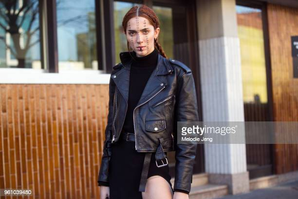 Model Teddy Quinlivan exits the Diesel Black Gold show in the face makeup and wears a black outfit leather jacket and dress during Milan Men's...