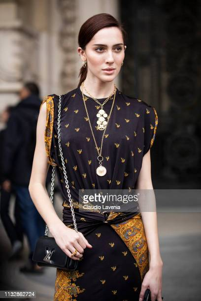 Model Teddy Quinlivan wearing a printed dress and black Louis Vuitton bag is seen outside Paco Rabanne on Day 4 Paris Fashion Week Autumn/Winter...