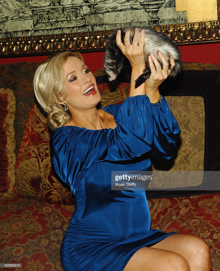 Model & television personality Holly Madison appears with her ferret Sid at the Animal Foundation's Shelter Elves kick off celebration at the House of Blues Foundation Room inside the Mandalay Bay Resort & Casino on December 1, 2012 in Las Vegas, Nevada.