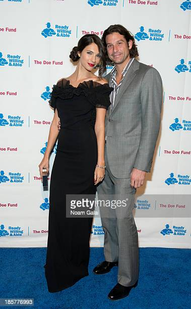 Model Teresa Moore and guest attend the 2013 Doe Fund gala at Cipriani 42nd Street on October 24, 2013 in New York City.