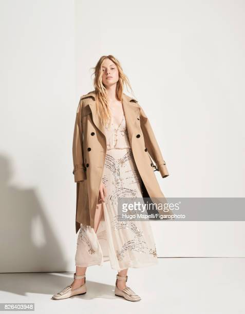 Model Tes Linnenkoper poses at a fashion shoot for Madame Figaro on June 30 2017 in Paris France Trench dress rings shoes CREDIT MUST READ Hugo...
