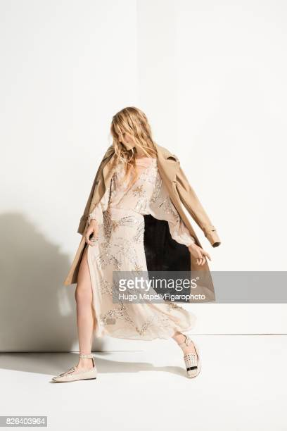 Model Tes Linnenkoper poses at a fashion shoot for Madame Figaro on June 30, 2017 in Paris, France. Trench , dress , rings , shoes . CREDIT MUST...