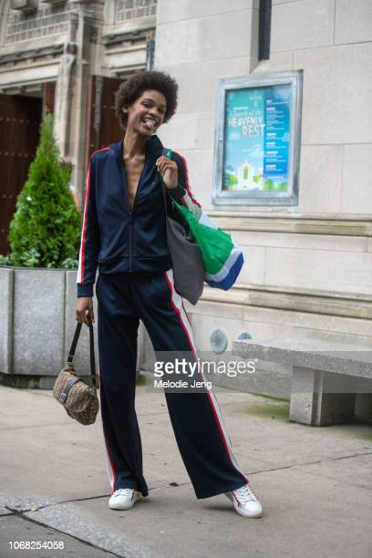Model Theresa Hayes wears a blue tracksuit white Tory Sport sneakers after the Tory Burch show during New York Fashion Week Spring/Summer 2019 on...
